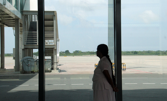 Index a local tourist looks at the empty runways