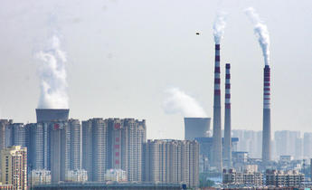 Aside w5gk1a smoke is discharged from chimneys in shangdong china