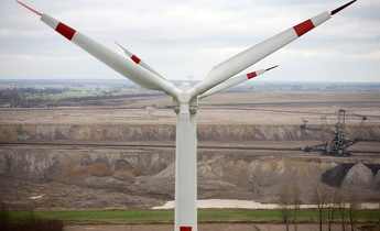 Index gp01oeg wind turbine overlooks coal mine in poland