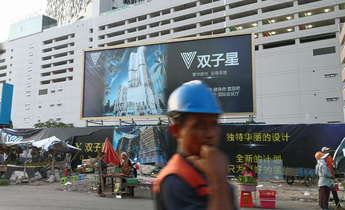Aside construction sites grounded with chinese billboards