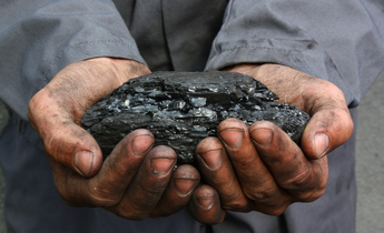Aside coal in hands