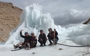 Aside ice stupa kids