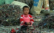 Aside a chinese child sits amongst a