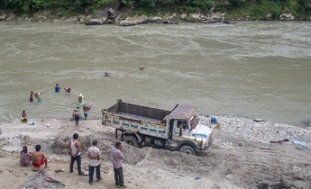 Aside sand mining in the trishuli river in dhadhing