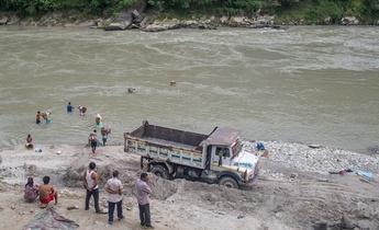Aside sand mining in the trishuli river in dhadhing