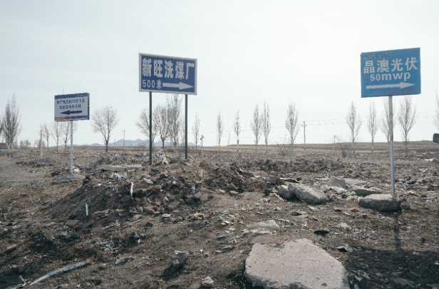 signposts with arrows at a road junction south of Datong