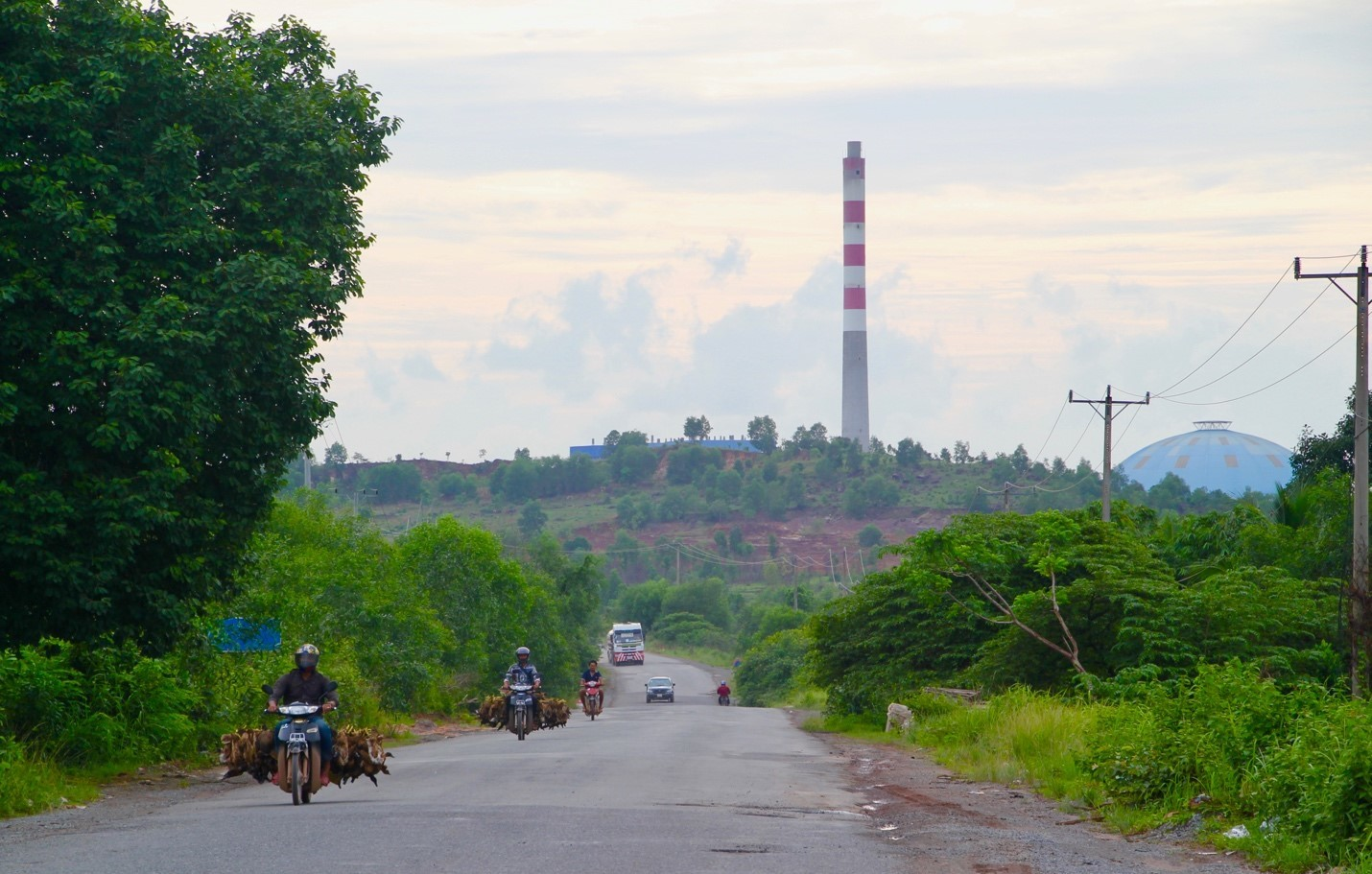 A smokestack rises over the hills of Sihanoukville, Cambodia (Image: Lili Pike)