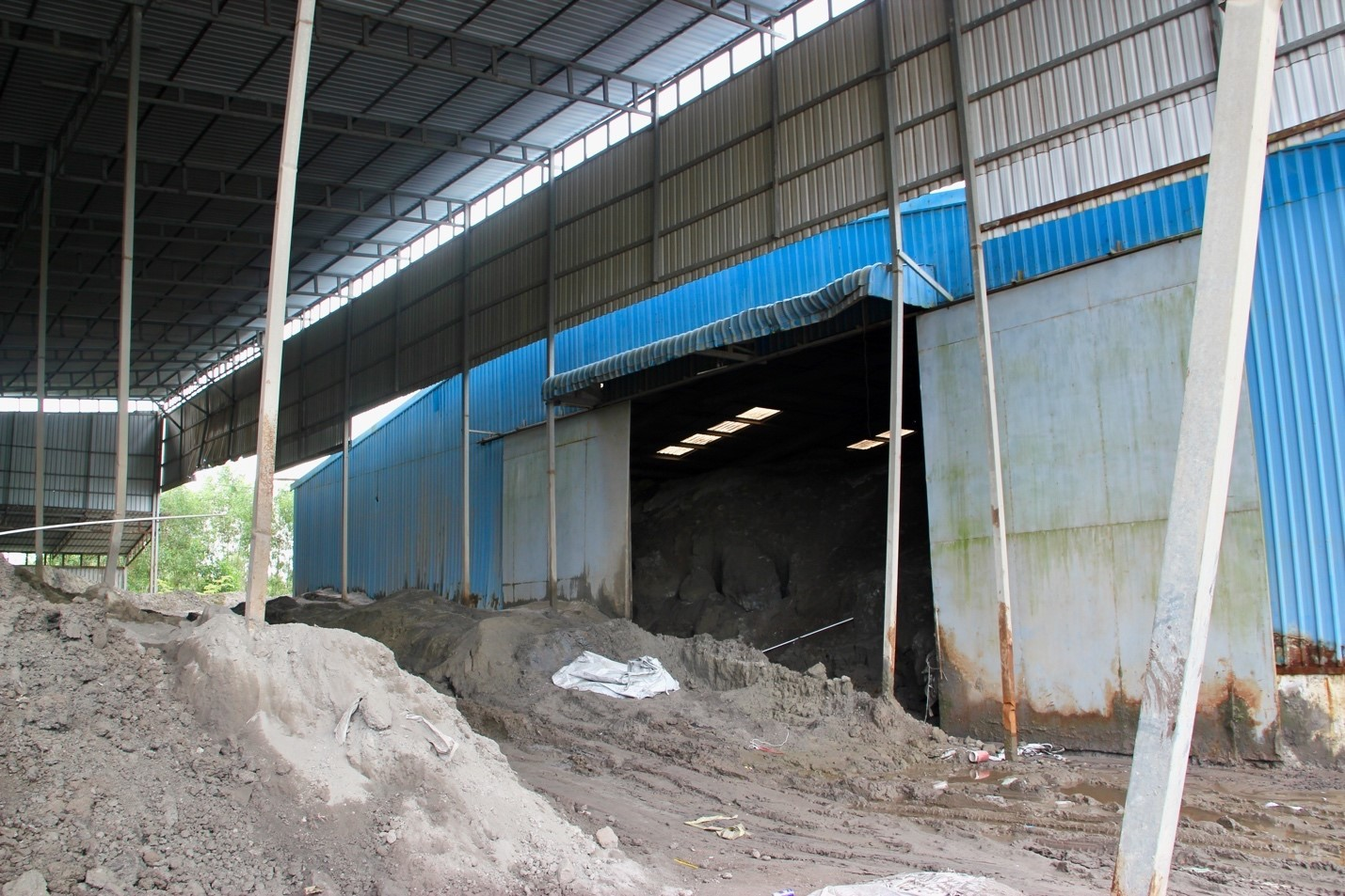 Coal ash, stored in the blue warehouse (Image: Lili Pike)
