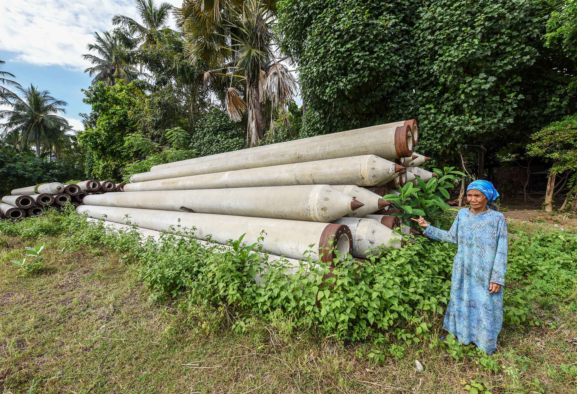 Foundation piles dumped on the edge of Surayah's land when the power plant was built in 2015 (Image: Ade Dani)