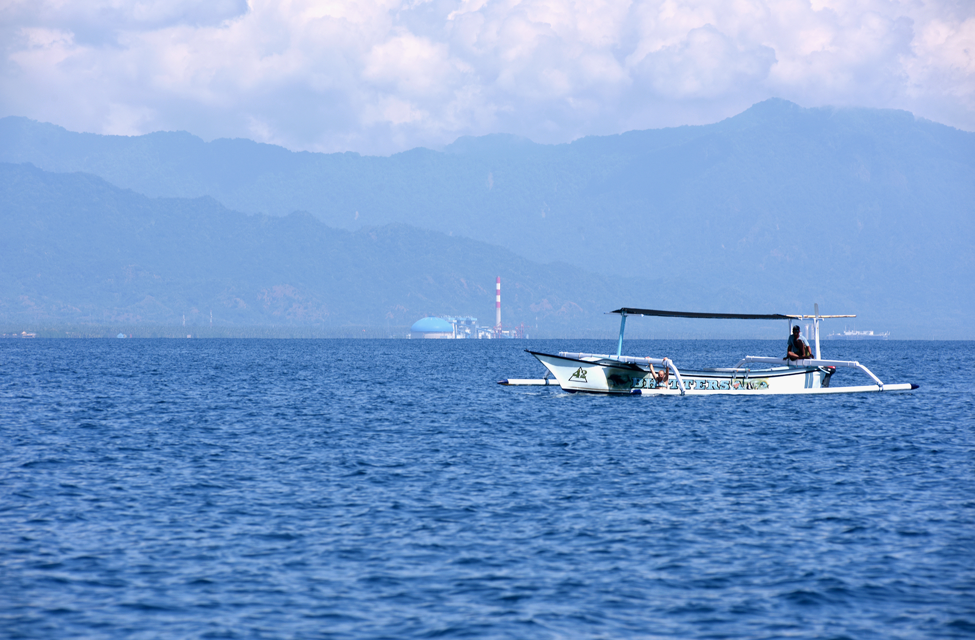 A tourist boat waits for dolphins off the north coast of Bali near Celukan Bawang. Dolphins and whales have become harder to spot since the power plant started operating. (Image: Ade Dani)